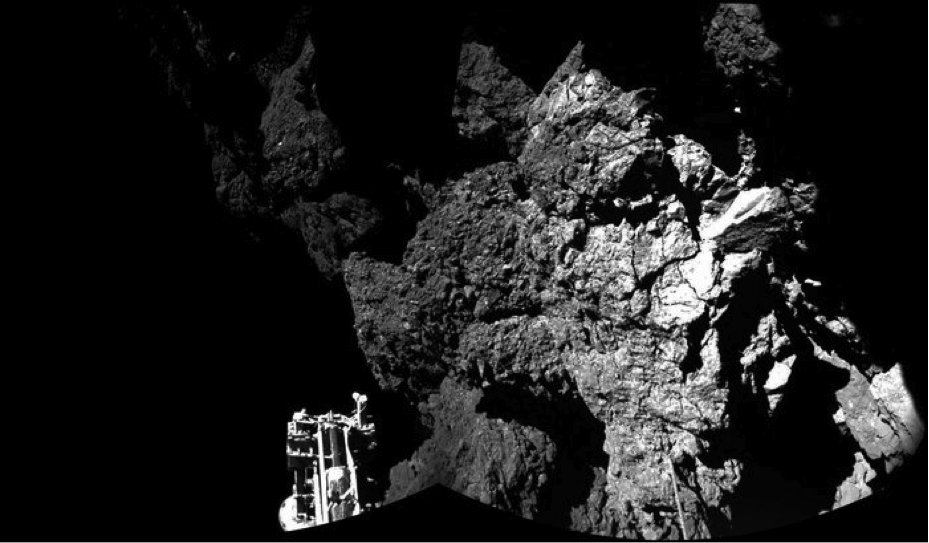 First image returned from surface of Comet 67P, with foot of lander in foreground. Image courtesy ESA.